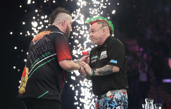 world darts championship event featuring two darts players shaking hands