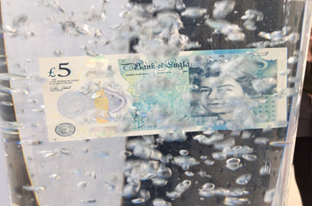 Floating bank note in bubble tube
