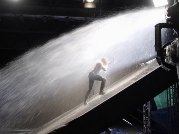 Dermot Kennedy being pushed by water effects for music video