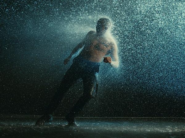 Dermot Kennedy with rain effects around him for music video