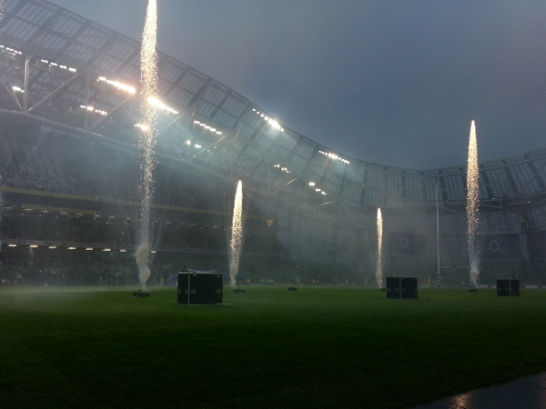 Rugby game with flames coming from the pitch