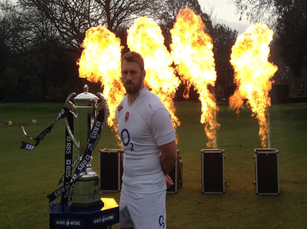 Rugby player standing in front of flame machine