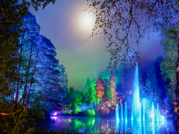 Dancing fountains with colorful neon background