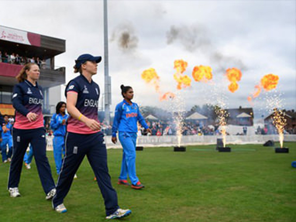 Cricketers walking onto pitch with Flame Effects next to them