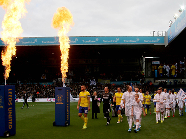 Players walk onto the pitch with Pyrotechnics